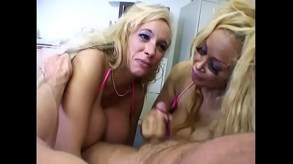 Babe with hgue titties is giving head to guy with her friend