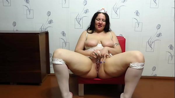 Chubby milf in stockings masturbates with a dildo on the chair. Big tits, juicy PAWG, and shaved pussy of an appetizing housewife. Homemade fetish.
