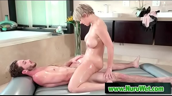 Busty masseuse using her boobs for massage