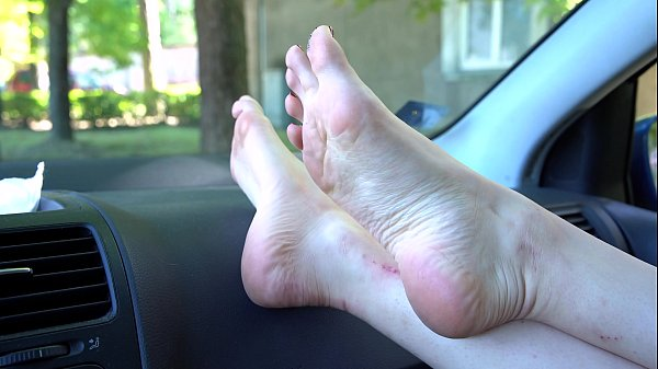 Pretty Feet Model With Tiny Feet Shows Her Soles In The Car