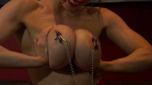Busty Muscular Ginger With Nipple Clamps