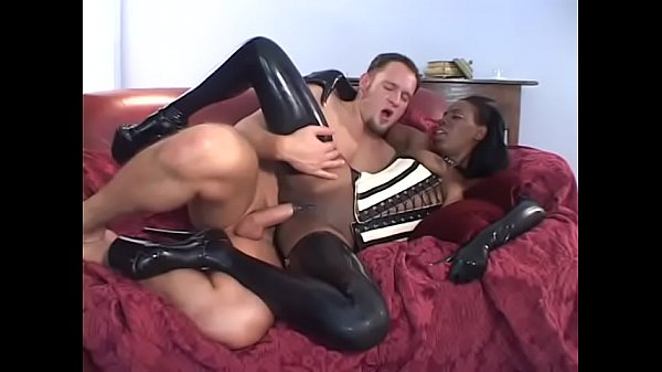 Ebony babe Lady Armani dressed in latex gets rammed hard from behind in bed