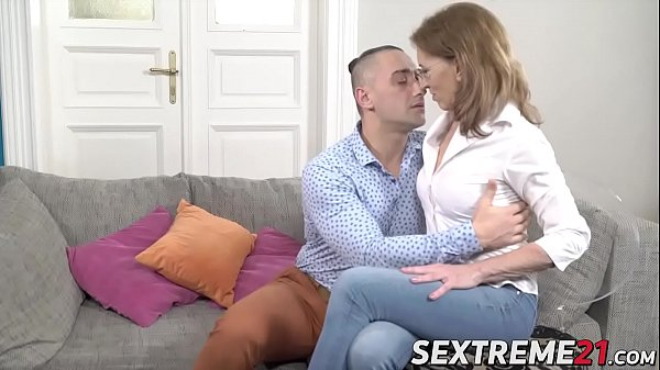 Wicked mature woman grabs the dick and fucks on a couch