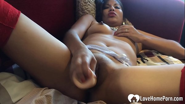 Stepsister in red stockings uses a sex toy