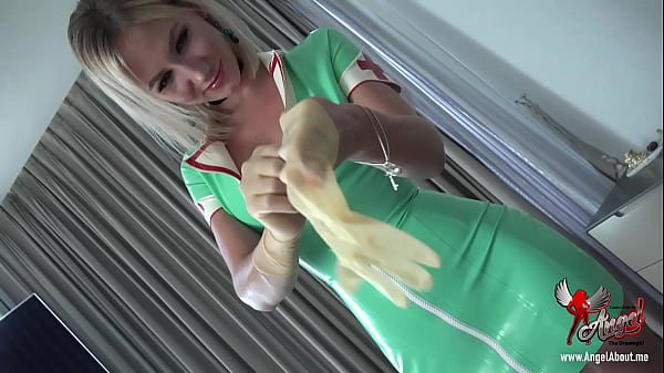 hot nurse in latex putting on medical gloves Thumb