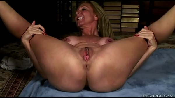 Mature yoga babe stretches and fucks her soakin...
