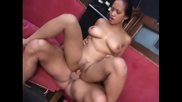 Asian nurse chick Loni blows a stiff dick and gets her pussy pounded on the couch