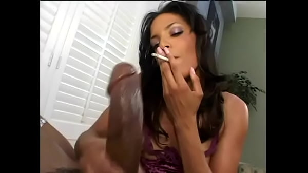 Gorgeous fit Latina smokes a cigarette while giving an amazing handjob