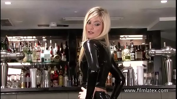 Classy latex barmaid Chritianas high heels and tall slim blonde in fetish wear ready to serve drinks and a good time