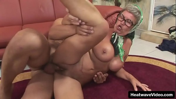 Older woman has huge tits and a love of hard cock as she fucks the young photographer