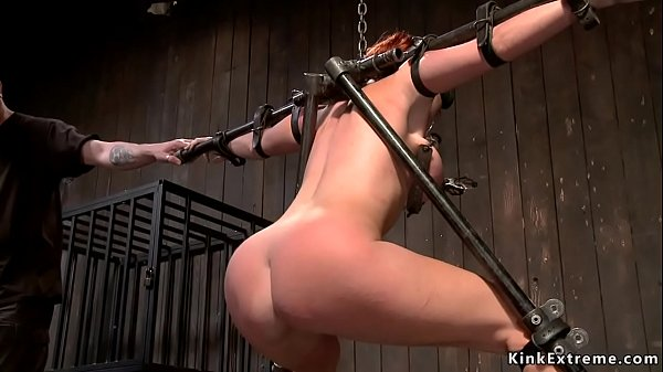 Slut is strapped to metal device whipped