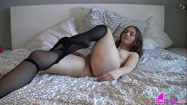 Babe in thin black socks masturbates