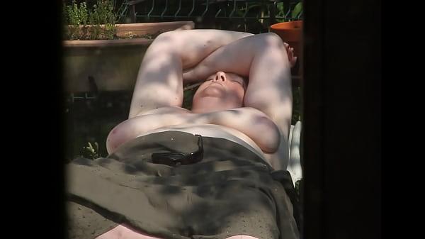 Topless sunbathing Thumb
