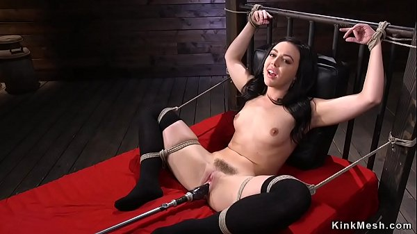 Raven haired beauty fucks machine bdsm