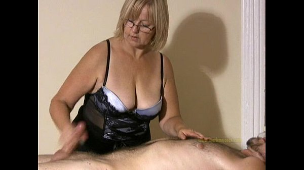 Big titted professional masseuse sensually mass...