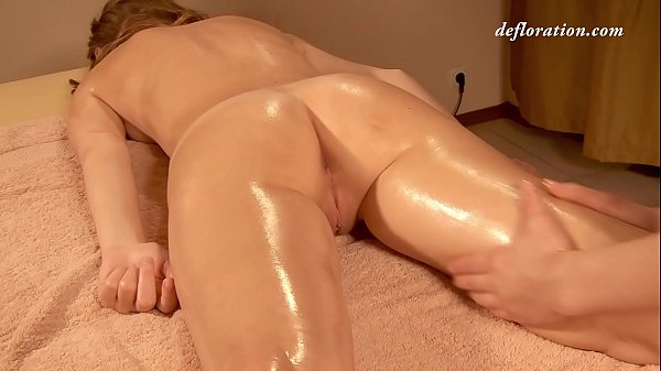 Elena being oil massaged by another girl