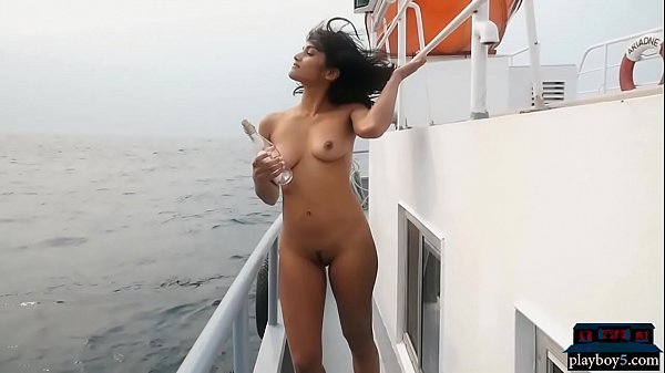 Exotic Playboy model gets naked outdoor and on a boat