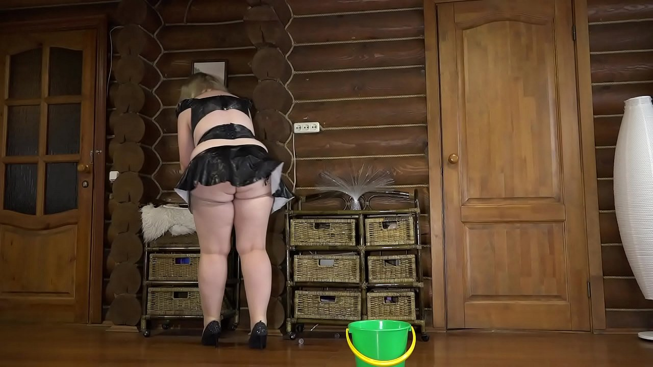 Mature maid in vinyl uniform cleans the house and masturbates with a large rubber dick. Big ass, natural boobs and a fat belly shake sexually.
