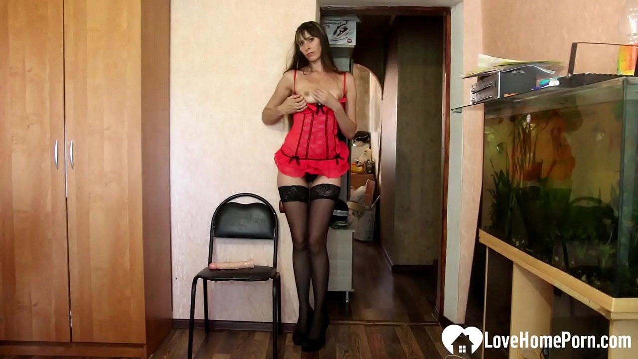Horny stepmom in stockings uses a dildo