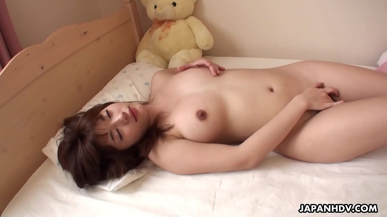 Mai Misato masturbates in bed beside teddy bear