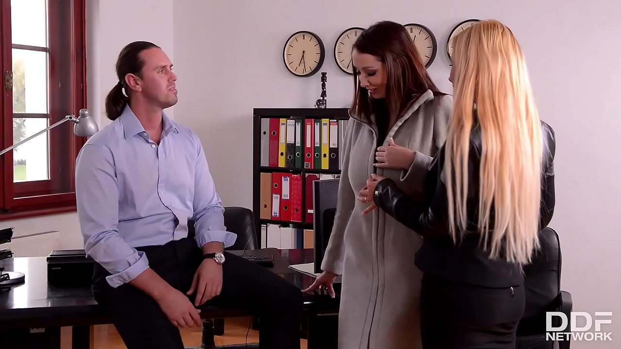Busty babes Kyra Hot and Lucie Wilde eat pussy and suck cock in the office
