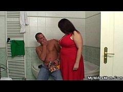 Huge boobs mother-inlaw helps him cum