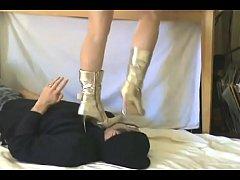 Girl in Boots Trampling Boyfriend
