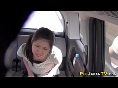 Asian pees in taxi cab
