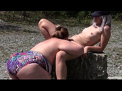 Lesbian licks a very hairy wet pussy outdoors. ...