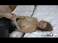 Blonde mature gets her big natural tits covered...
