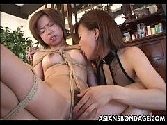 Sexy Japanese domina fingers a cute brunette