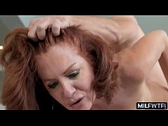 Mature woman with a hairy snatch and red hair