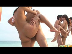 Group sex on the beach leads to creampie asian ...