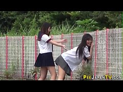 Asian teenagers outdoors urinate