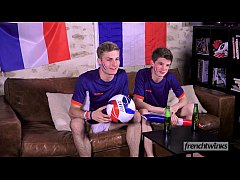 Two twinks support the French Soccer team in th...