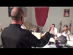 A priest shows in the FAKings school to teach a...