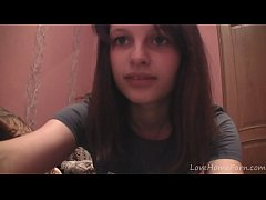 Beautiful brunette takes off her clothes on camera