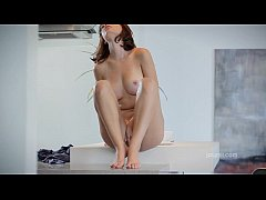 Redhead hottie pleases her pussy