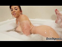 Busty Milf Sara Jay Pours Hot Wax on Her Huge T...