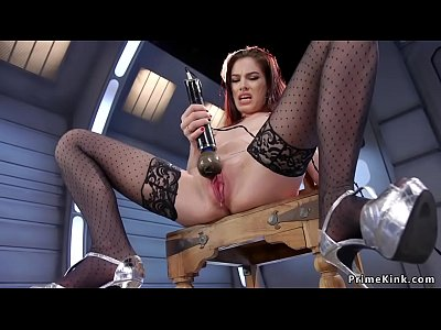 Wet pussy redhead in stockings fucks machine
