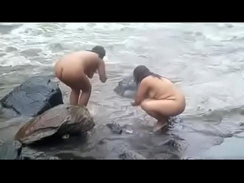 Women bathing nude
