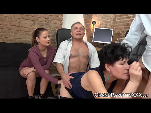 Teen jerks her lover off while they watch seniors fuck hard