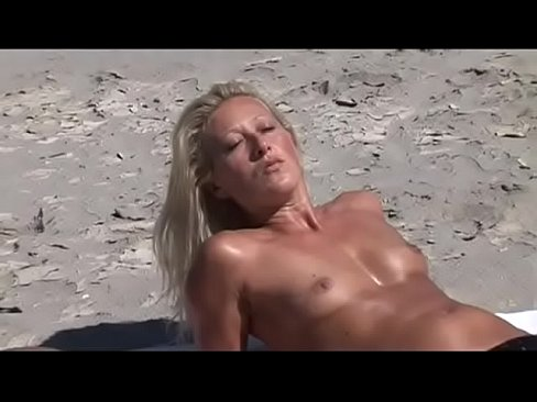 Passion on the beach for a Milf Slut