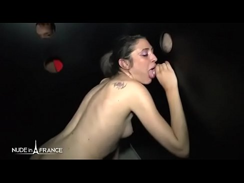 Gloryholes and orgy for a young french slut in a swinger club