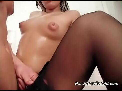 Hot babe gets her stockings sprayed with warm jizz