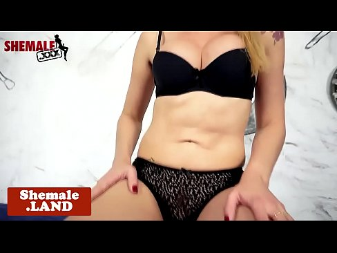 Solo bigtitted tranny sensually pulling cock