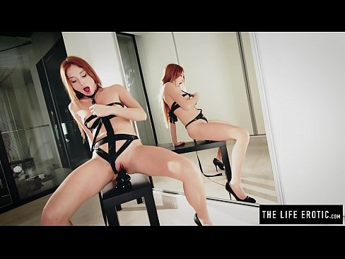 Freckle faced redhead in straps rides a giant dildo really hard