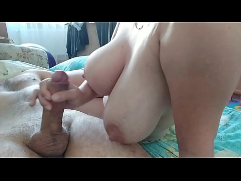 She jerks off her boyfriend's cock in the morning so that he wakes up