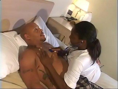 Black nurse Brown Sugar in fishnets enjoys her wet cunt penetrated deep by a huge pole