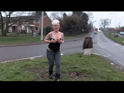Dexy milf pisses herself in public and shows her ass to passing cars